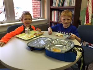 Isaiah and Ethan enjoying 3B's lunch in Mrs. Hannon's office.